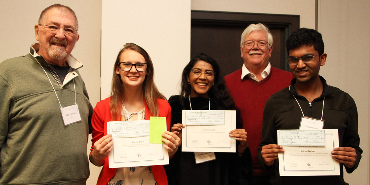 Essay contest winners Khayla Black, Sunidhi Ramesh and Prithvi Nathan; Supporter Dr. Michael Patterson; Hank Greely, past president of the INS